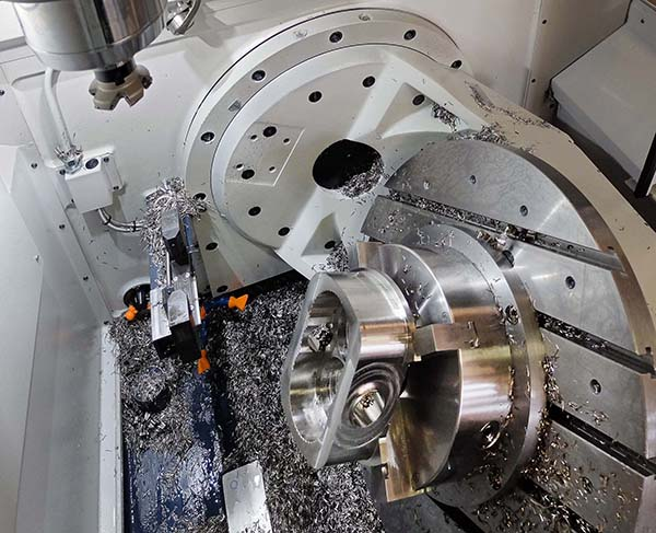 Five-axis machining centre halves cycle time